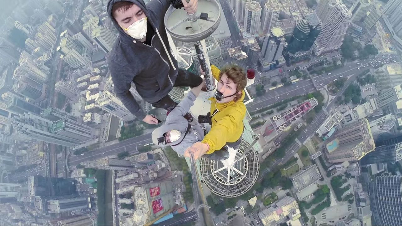 Three men from Russia and Ukraine climbed to the pinnacle of one of the world's tallest towers, bare-handed, to take selfies at the top. Again.